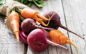 Carrot and beet on rustic background